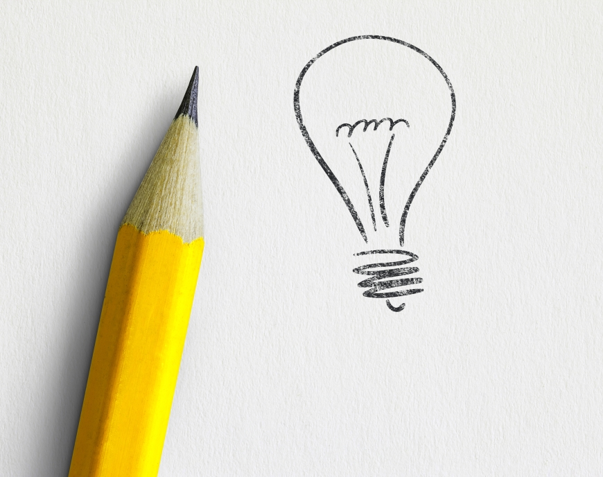 pencil next to drawing of lightbulb