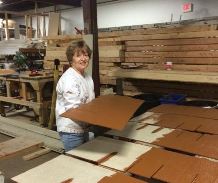 Pat Ocheltree painting roof shingles