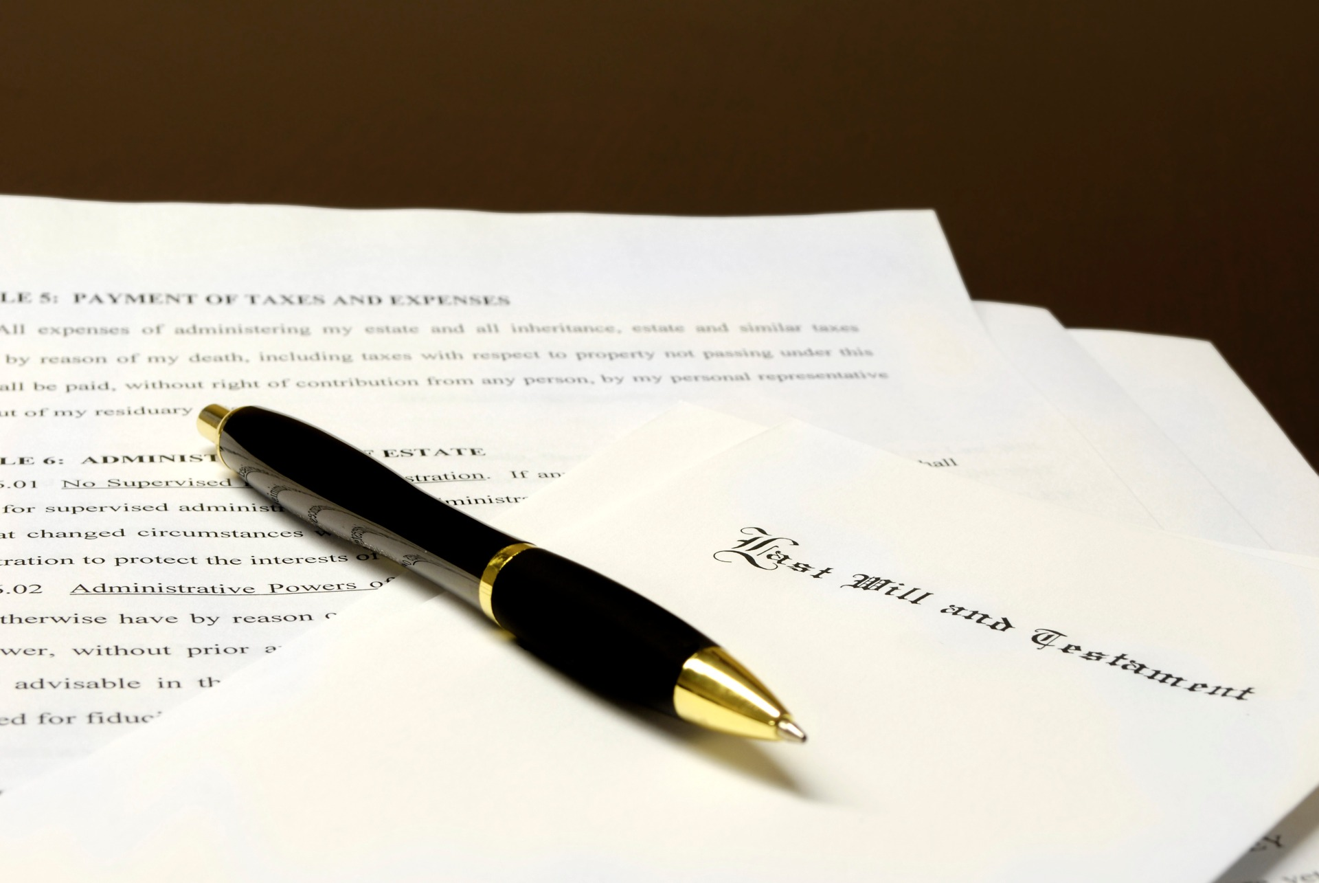Pen laying on top of a Will for estate planning