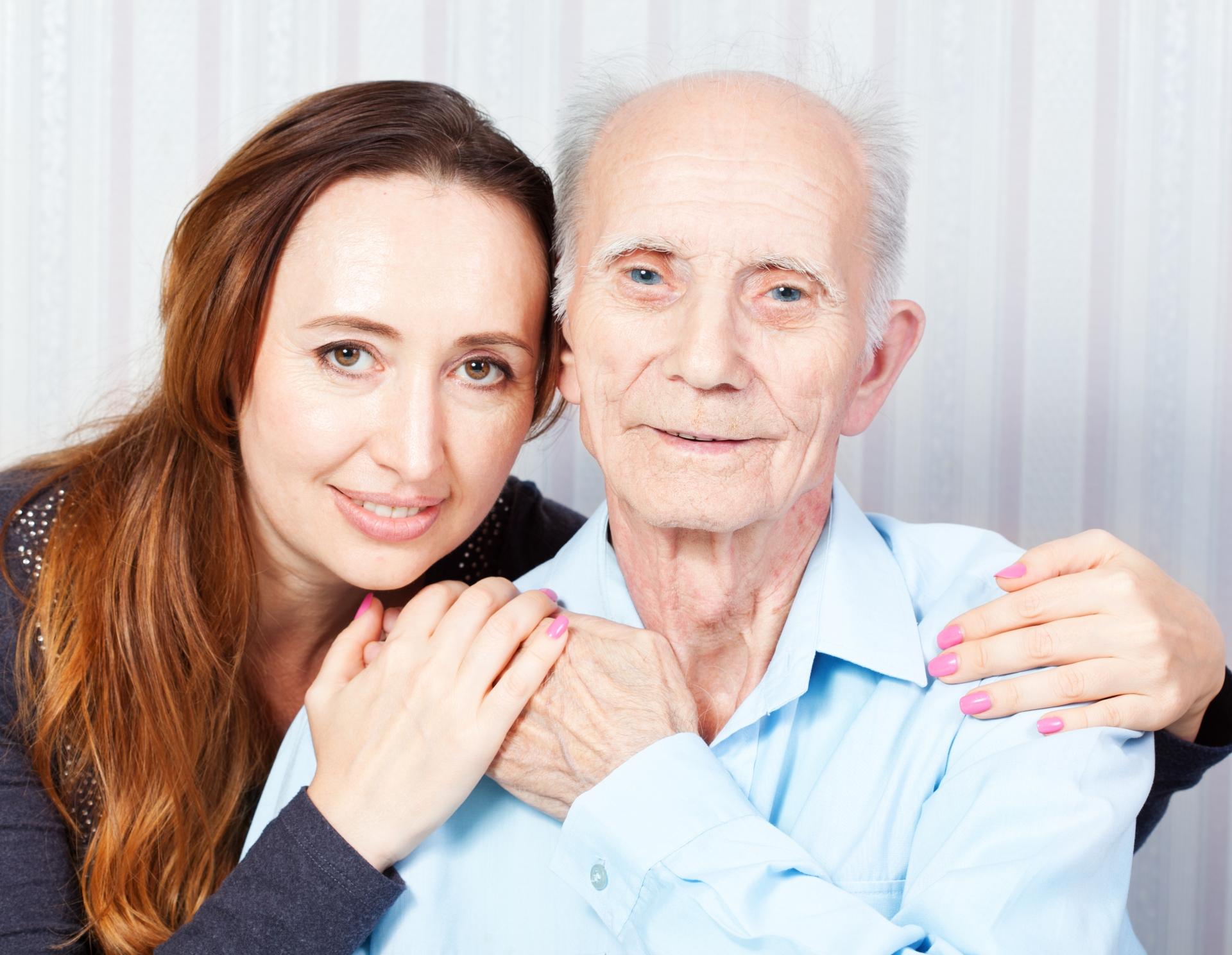 Senior with caregiver family member.
