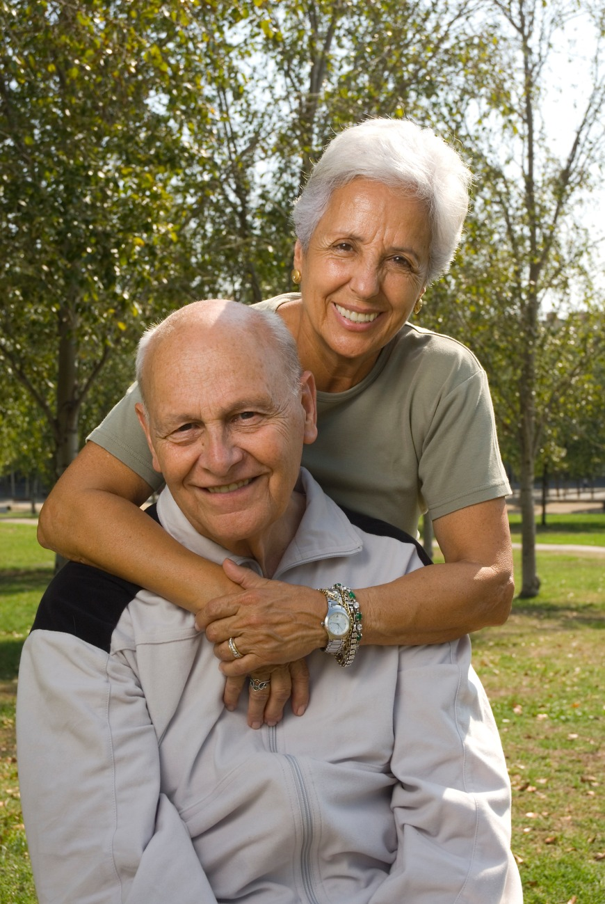 Loving, handsome senior couple relaxing in the park