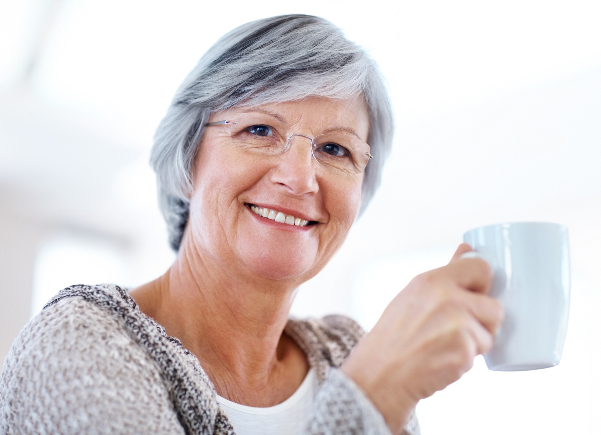 Woman smiling while holding a coffee cup
