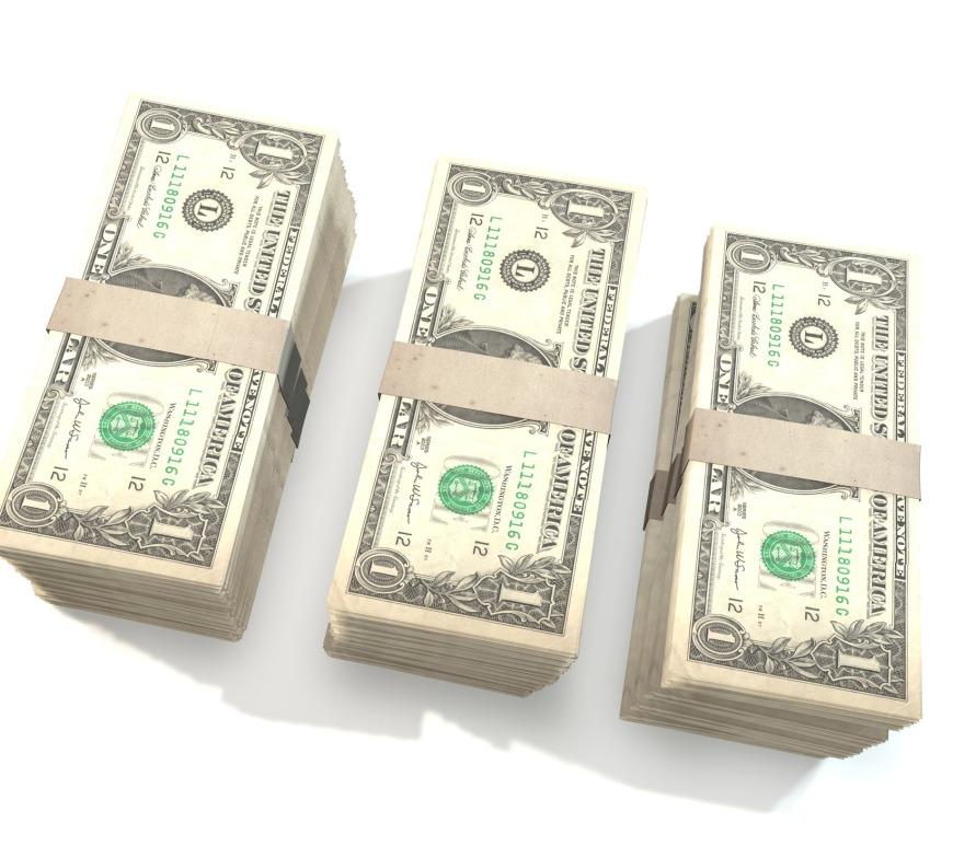 Stacks of dollar bills.