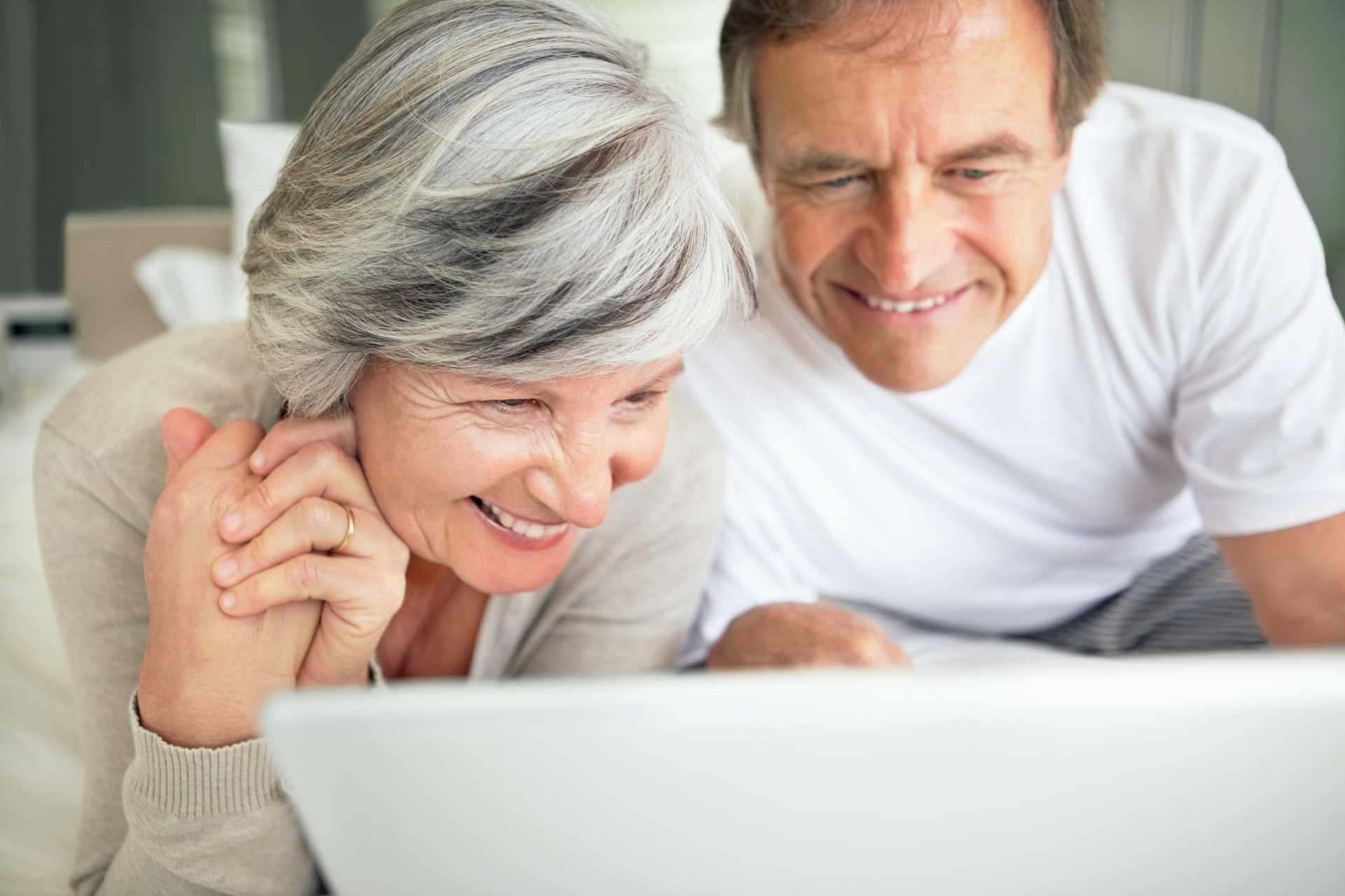 Smiling couple looking at computer.