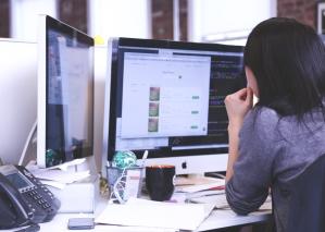Employee working on computer.