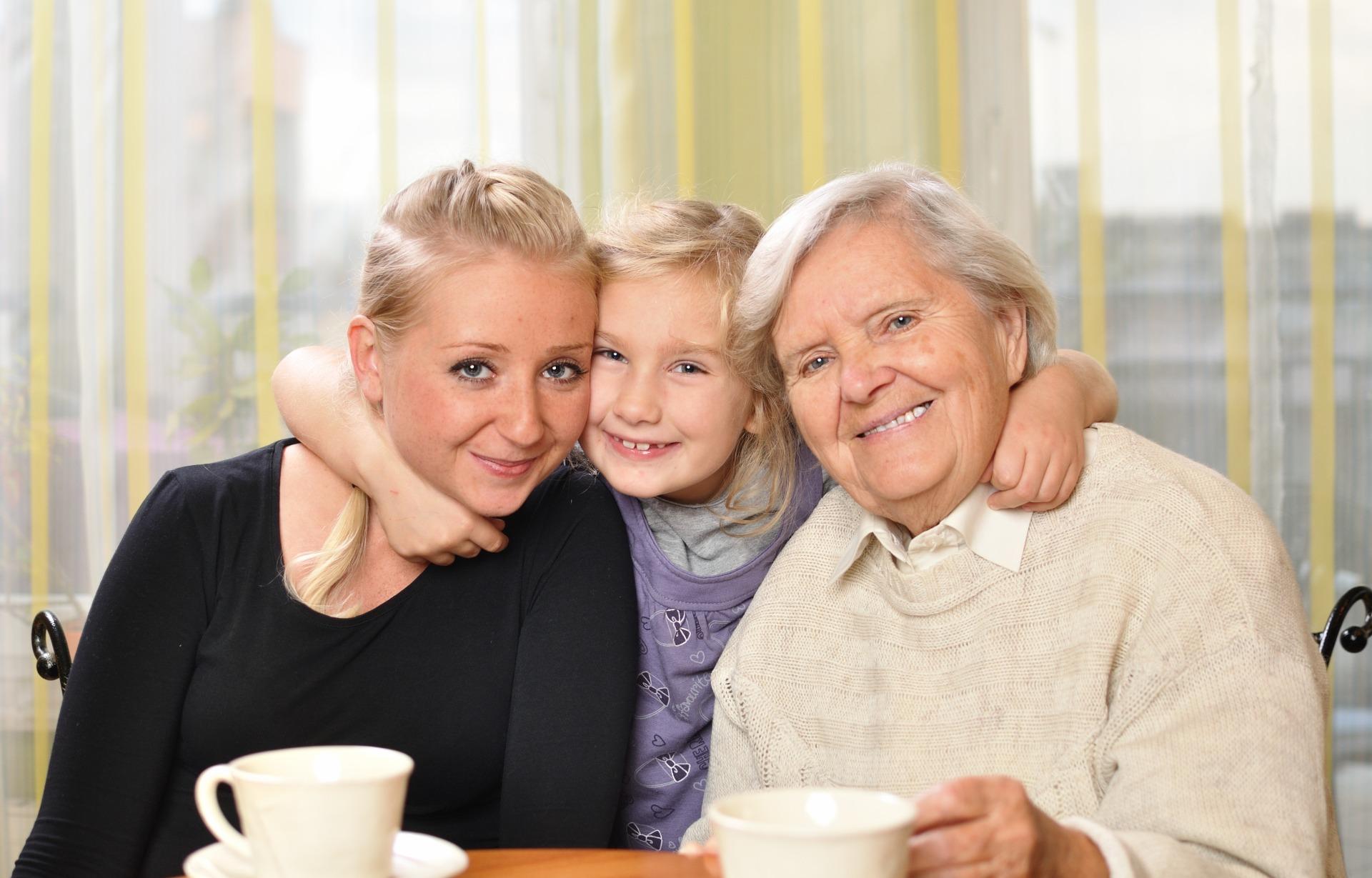 Three women, three generations. Happy and smiling.