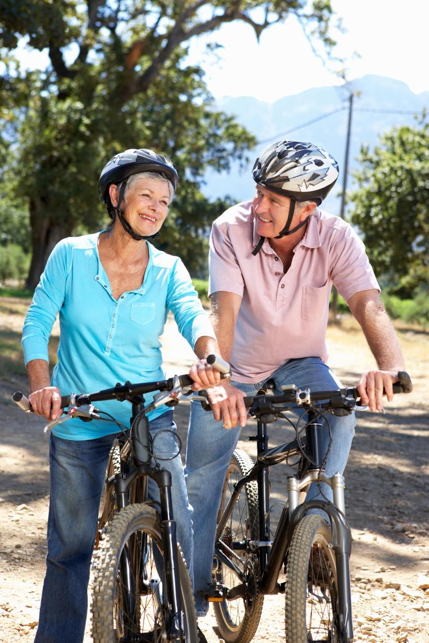 A couple riding bikes.