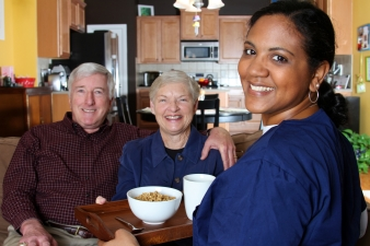 Caregiver helping seniors.