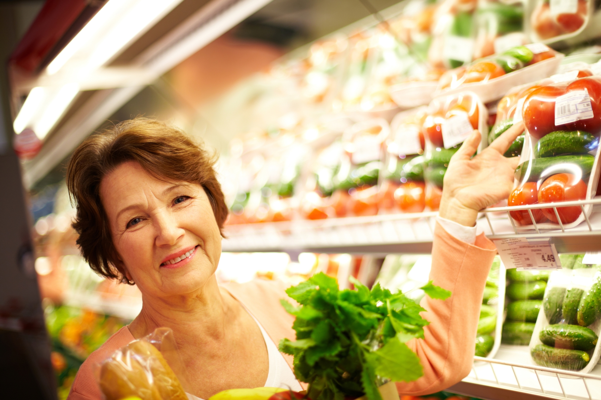 Woman smiling in the produce aisle.