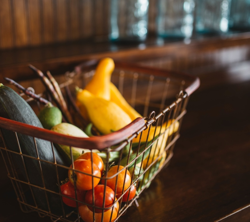 Grocery basket of fruits and vegetables.