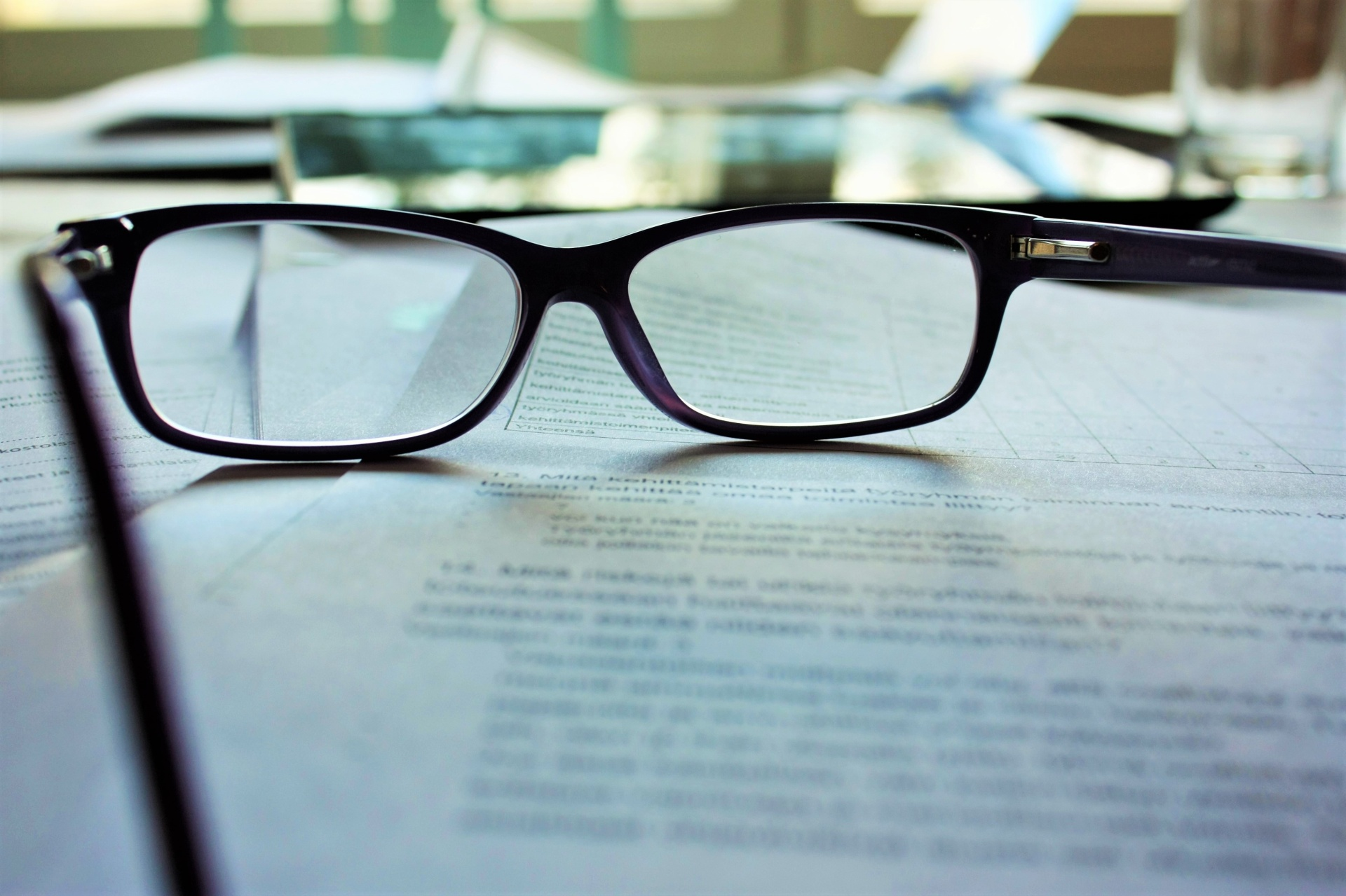 Eyeglasses sitting on paper.