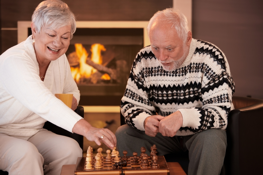 A couple playing chess.