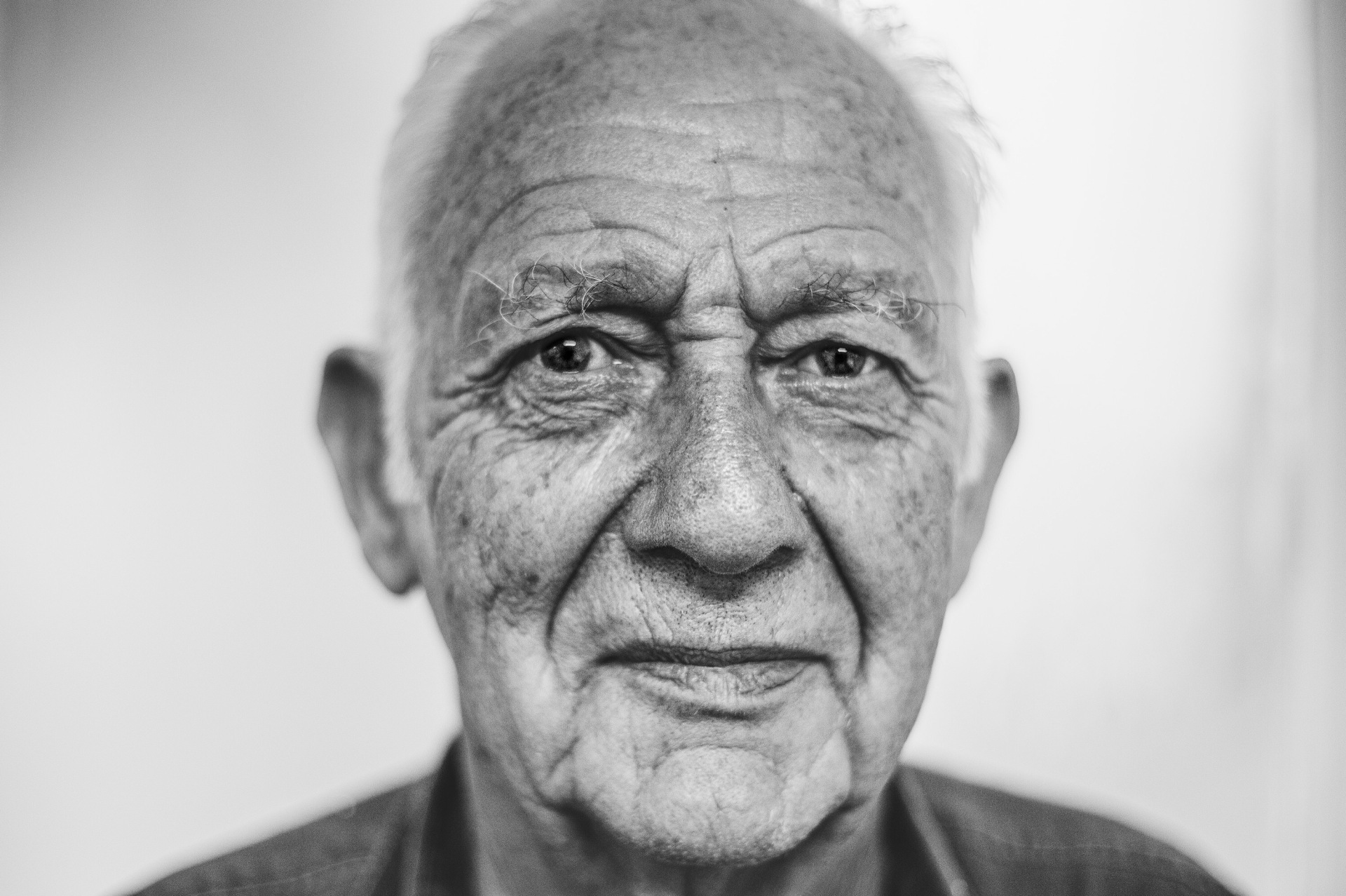 Headshot portrait of elderly man.