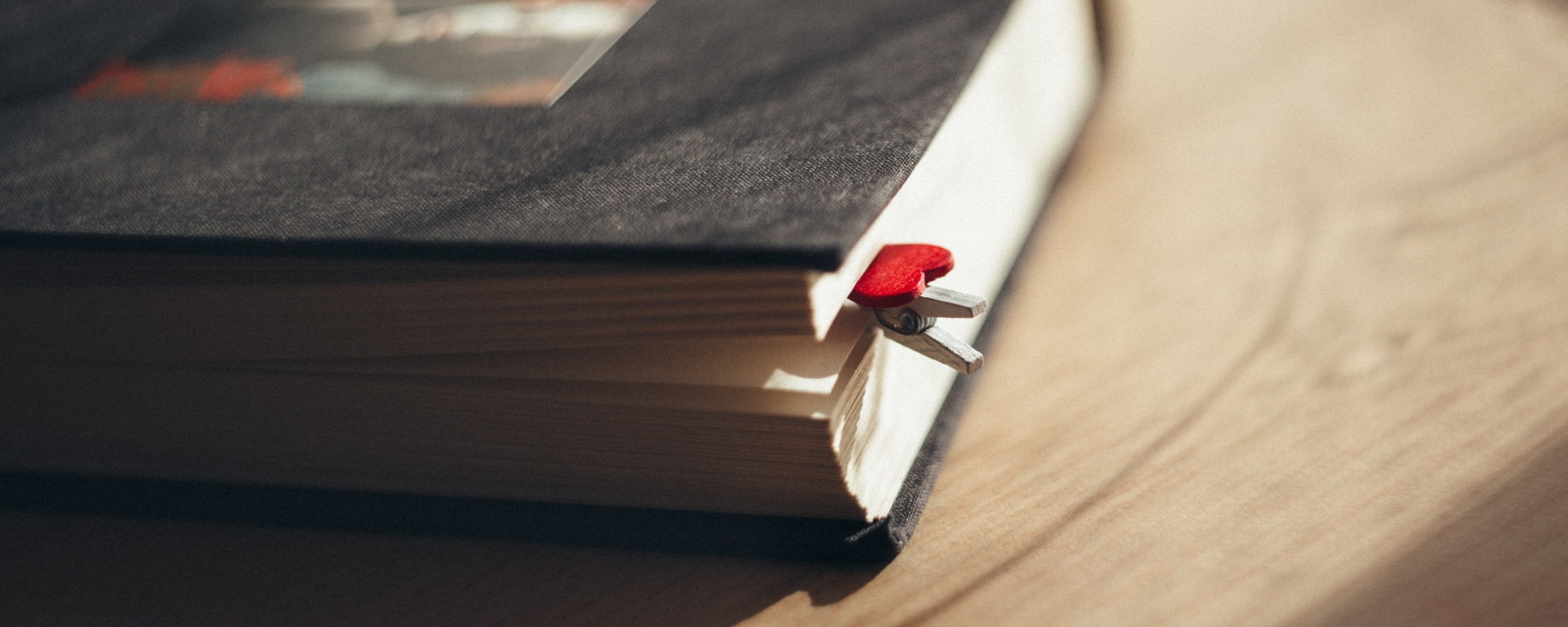 black hardcover book with a heart paperclimp
