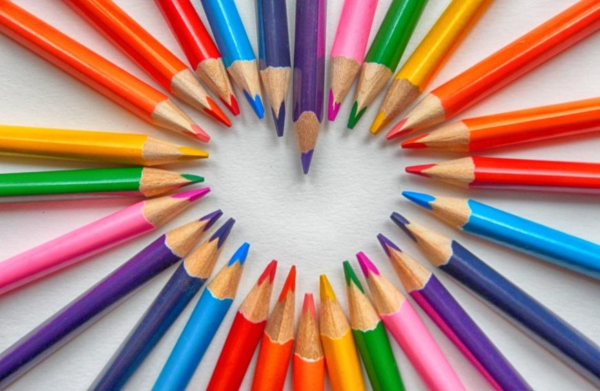 coloring pencils forming a heart