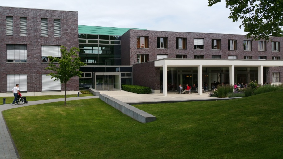 Wide shot of the front of a brick residential facility.