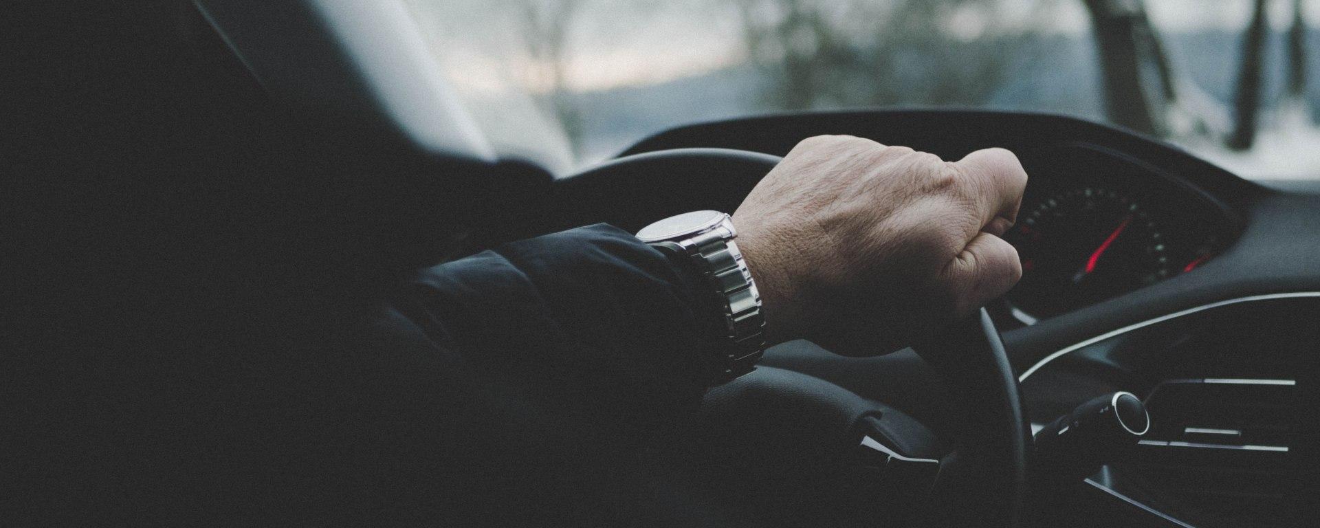 Hand over steering wheel
