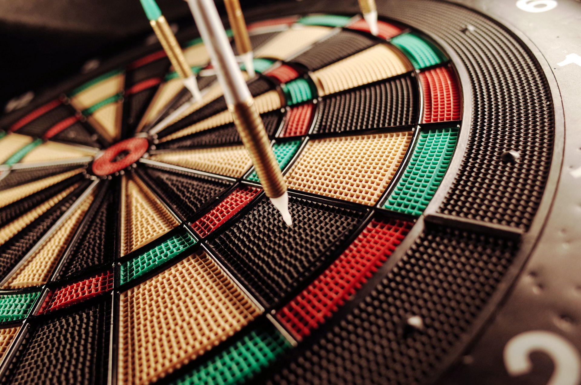 Darts on a dart board.