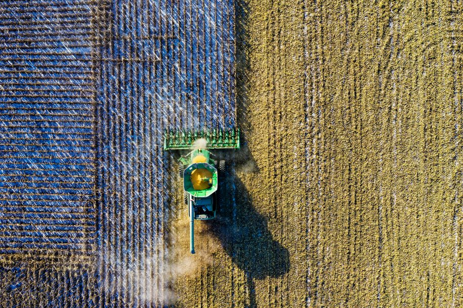 Birds-eye view of a tractor harvesting crops.